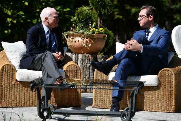 Srdjan Ilic: US senator John McCain (left) and PM Aleksandar Vucic (right)